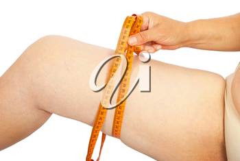 Fat woman measuring her thigh