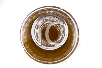 Close-up of Crystal decanter for alcoholic beverage over white (shallow DOF)