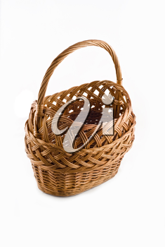 Beautiful Wicker woven basket over white background