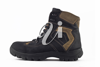 Side view of Warm leather boot for wearing in winter or traveling (isolated, over white)