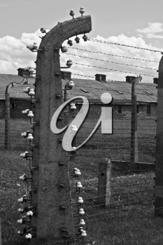 Wire fence and barracks in Auschwitz - Birkenau concentration camp, Poland
