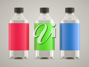 Three bottles for chemicals or fluids with colorful stickers over grey background
