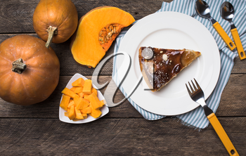 pumpkins and pie on plate in Rustic style. Food photo