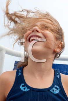 Royalty Free Photo of a Girl on an Amusement Park Ride With Her Hair Blowing