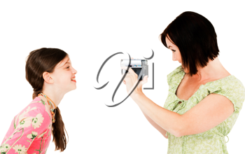 Royalty Free Photo of a Woman Filming a Young Girl