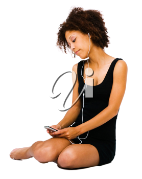 Young woman listening to music on a MP3 player isolated over white