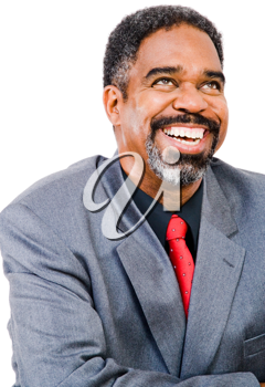 Confident businessman posing and laughing isolated over white