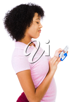 Happy teenage girl text messaging on a mobile phone isolated over white