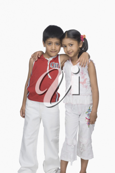 Portrait of a boy and his sister arm around