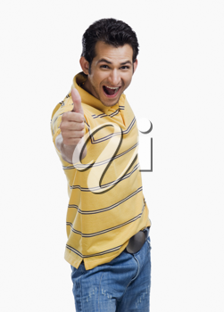 Portrait of a man showing thumbs up sign