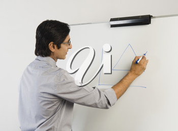 Teacher writing on a whiteboard