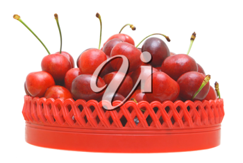 Sweet cherry fruits in a red plate on a white background.