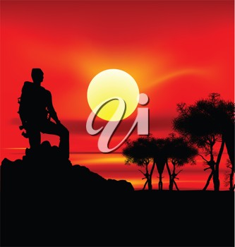 Royalty Free Clipart Image of a Silhouetted Backpacker on a Hill at Sunset