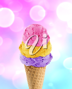 three Ice cream scoops in the cone with abstract light background.