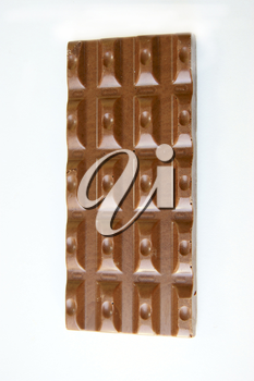 Aiming bar of chocolate on white background is insulated