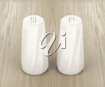 Porcelain salt and pepper shakers on the wood table