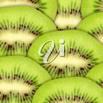 Abstract green background with raw kiwi slices. Close-up. Studio photography.