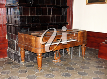 The old harpsichord costs in a room at a wall