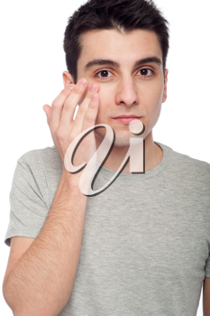 Royalty Free Photo of a Man Applying Eye Cream
