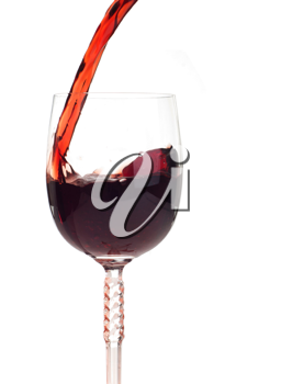 Royalty Free Photo of Red Wine Being Poured into a Glass