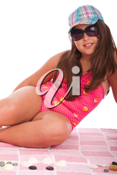 Royalty Free Photo of a Girl Sitting at the Beach