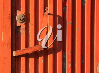 Royalty Free Photo of an Orange Rusty Iron Door as a Background