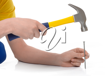 Royalty Free Photo of a Man Hammering a Nail