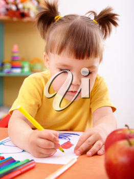 Royalty Free Photo of a Little Girl Making a Picture