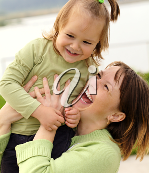Royalty Free Photo of a Mother and Daughter Playing Outside