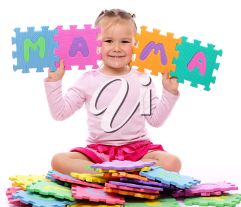Royalty Free Photo of a Girl With Foam Pieces That Spell Mama