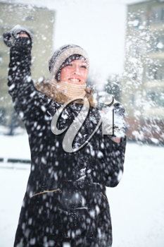 Royalty Free Photo of a Young Woman in a Snowball Fight