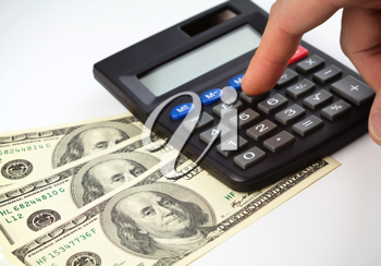 Royalty Free Photo of Money and a Calculator