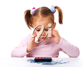 Royalty Free Photo of a Little Girl With a Calculator and Money