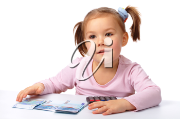 Royalty Free Photo of a Little Girl With Euros and a Calculator