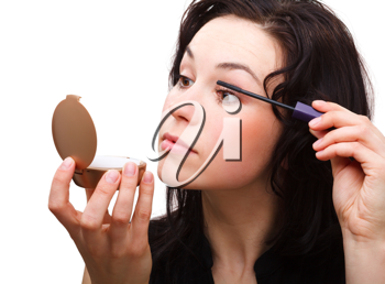 Royalty Free Photo of a Woman Putting on Mascara