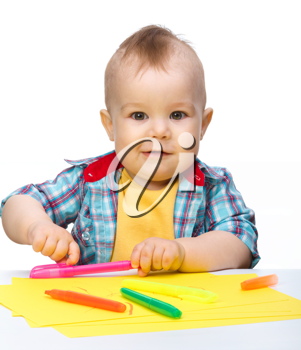 Royalty Free Photo of a Boy With Markers