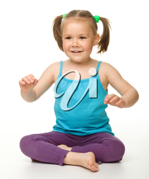 Royalty Free Photo of a Child Sitting on the Floor