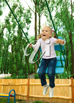 Royalty Free Photo of a Little Girl on a Swing