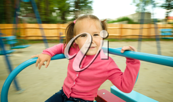 Royalty Free Photo of a Little Girl Playing Outside