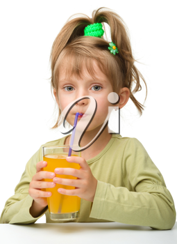 Royalty Free Photo of a Little Girl Drinking Juice