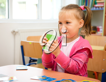 Royalty Free Photo of a Little Girl Playing With Educational Cards