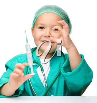 Royalty Free Photo of a Little Girl in Surgical Scrubs Holding a Needle