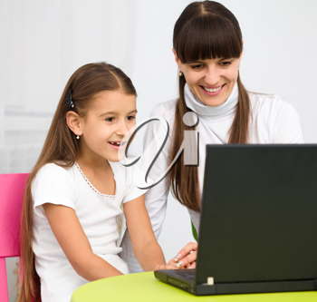 Royalty Free Photo of a Mother and Daughter at a Laptop