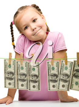 Royalty Free Photo of a Little Girl With Money on a Line