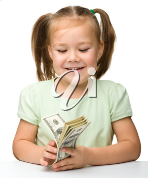 Royalty Free Photo of a Little Girl Holding Money