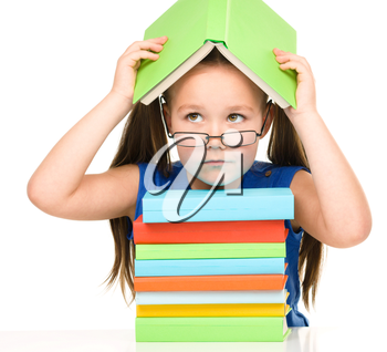 Sad little girl with books wearing glasses, isolated over white