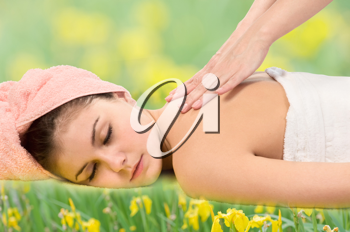 Royalty Free Photo of a Woman Getting a Massage on Grass