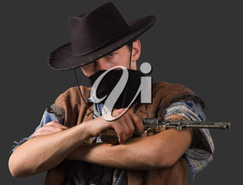 cowboy with revolver isolated on grey background.Shallow DOF