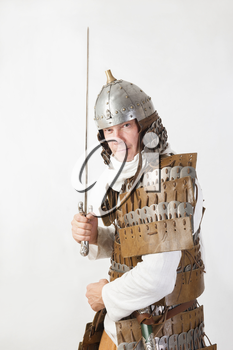 medieval warrior man wearing in ancient armor with sword