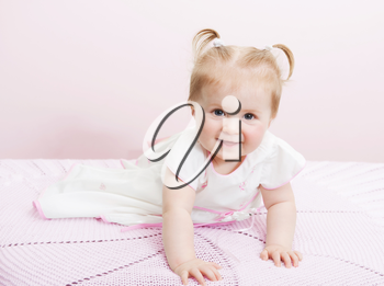Portrait of beautiful baby girl on a light background